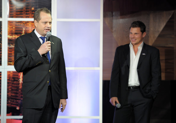 Nick Lachey President of Sports Illustrated Group Mark Ford and Nick Lachey onstage at Club SI Swimsuit hosted by Vanity at Vanity Nightclub at The Hard Rock Hotel and Casino on February 17, 2011 in Las Vegas, Nevada.