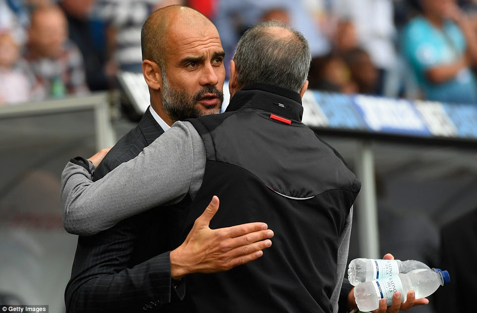 The two managers, Pep Guardiola of Manchester City and Francesco Guidolin of Swansea meet on the touchline in Wales