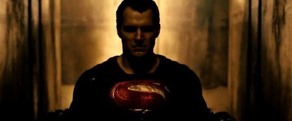 Superman walks down a dark hallway as he prepares to confront Batman in BATMAN V SUPERMAN: DAWN OF JUSTICE.