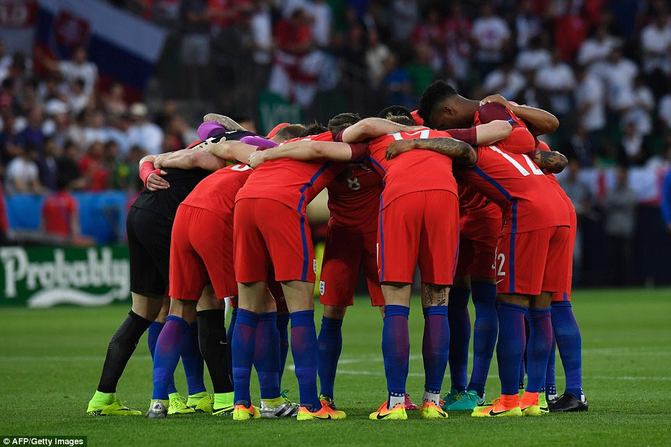 England's players take part in a huddle on the pitch at Stade Geoffroy-Guichard prior to the start of play
