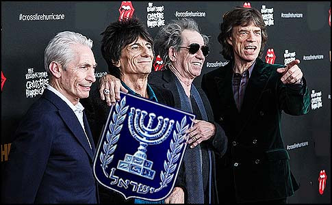Charlie Watts, Keith Richards, Ronnie Wood and Mick Jagger of The Rolling Stones presenting Israel's official symbol.