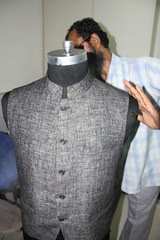 The Finishing Touches To My Sleeveless Jacket or Bundi by firoze shakir photographerno1