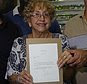 """Ileana Yarza, 76, center, surrounded by her family, holds a letter President Baracak Obama wrote to her as they pose for photos insider her home in Havana, Cuba, Thursday, March 17, 2016. Yarza wrote to Obama on Feb. 18 saying """"there are not many Cubans so eager as I to meet you in person."""" Obama wrote back that """"hopefully, I will have time to enjoy a cup of Cuban coffee"""" when he visits Havana Sunday. His letter flew to Cuba Tuesday on the first direct mail flight since shortly after the 1959 Cuban revolution. The letter had not yet been delivered until Thursday, but the White House released the text. (AP Photo/Ramon Espinosa)"""