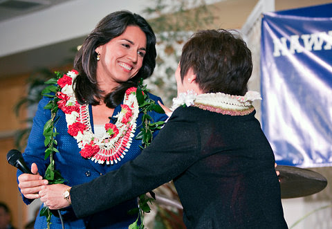 Tulsi Gabbard, left, is congratulated by fellow Democrat Colleen Hanabusa after her election to the House of Representatives on Tuesday in Honolulu, Hawaii.