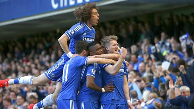 Chelsea celebrate Andre Schurrle's goal against Arsenal (Reuters)