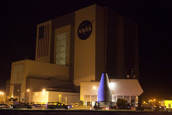 The payload fairing containing NASA's OSIRIS-REx spacecraft passes by the Vehicle Assembly Building at Kennedy Space Center in Florida...on August 29, 2016.