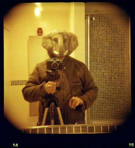 reflected self-portrait with Diana F+ camera and elephant mask by pho-Tony