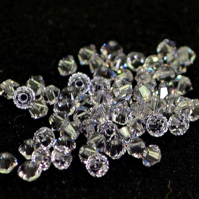 27753011069265 Swarovski Elements Bead - 3 mm Faceted Xilion Bicone (5328) - Smokey Mauve (36)
