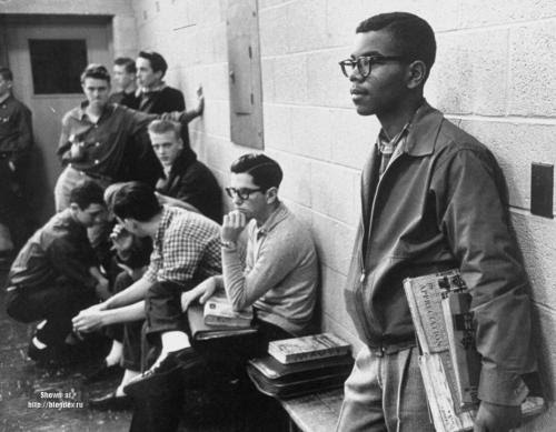 """collectivehistory:""""Standing Tall Amid the Glares"""" by Paul Schutzer.Lewis Cousins, age 15, the only African American student in the newly desegregated Maury High School, standing alone. 1959, Norfolk, VA."""