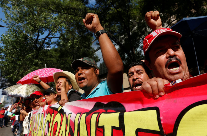 Protesters from the National Coordinator of Education Workers (CNTE) teachers' union march against President Enrique Pena Nieto