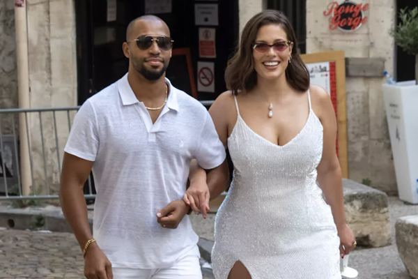 fc7b8bf58d6 Ashley Graham Showed Up to Sophie Turner's Pre-Wedding Bash in All-White &  with a Thigh-High Slit