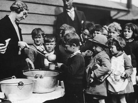 https://www.freedomsphoenix.com/Uploads/Graphics/171-1229082809-great-depression-boys-and-girls-in-soup-line.jpg