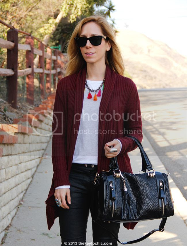 L.A. fashion blogger The Key To Chic wears an Isabel Marant for H&M white T-shirt and black waxed biker jeans with a Mellow World handbag, Charlotte Russe waterfall cardigan, and Topshop leopard boots