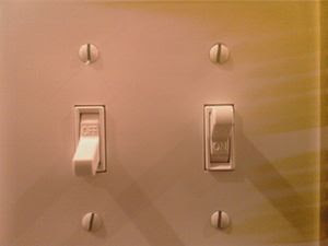 This is a picture of a light switch. displayin...