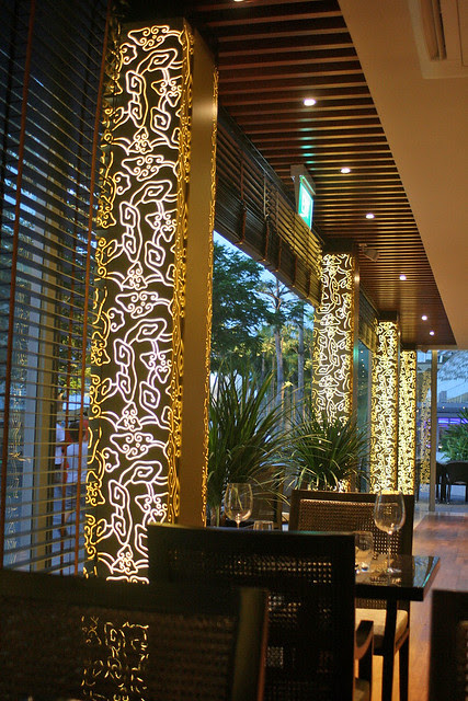 Modern ethnic art lights up the columns in the restaurant at night