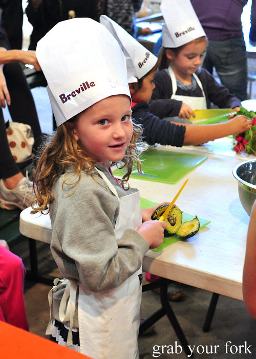 Kid chef with avocado at the Adelaide Showground Farmers Market