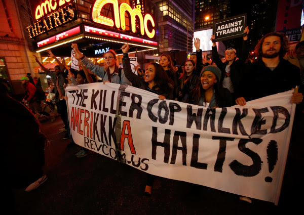 Image: People protest against the verdict announced in the shooting death of Michael Brown, in Times Square, New York