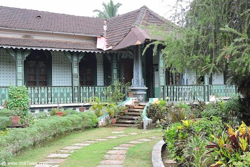 Green House with Filigree Pillars and Brackets. Madgaon Heritage Walk - Walk through the lovely Goan...