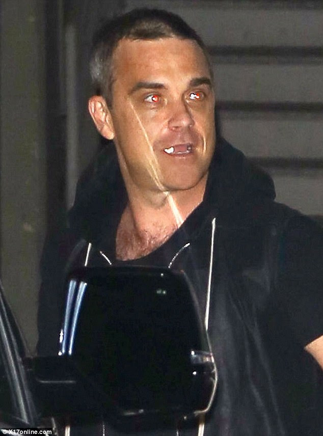 Living large: Adele's friend Robbie Williams looked like he was having a great time on his big night out