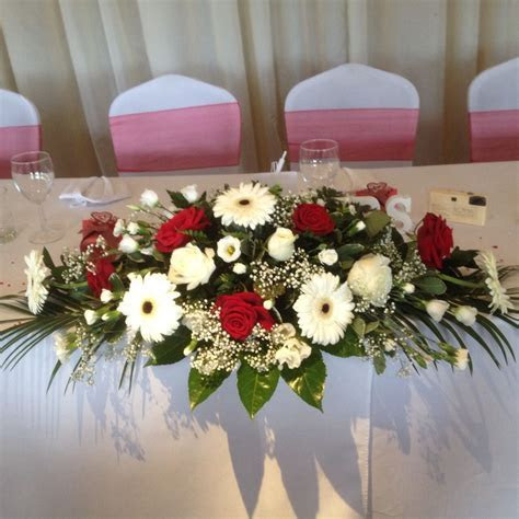 Top table arrangement In roses and gerbera red and white