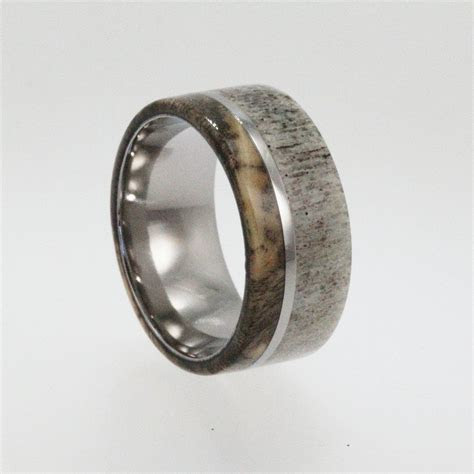 Titanium ring with Buckeye Burl Wood and Deer Antler Inlay