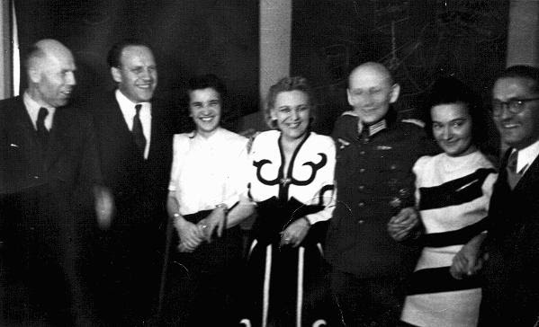 Scene from one of Oskar Schindler's parties in Krakow. At such events, Schindler (second from left) attempted to bribe Nazi officials for information about imminent deportations. Krakow, Poland, 1943.