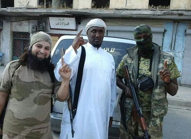 Militant: ChaIb (left) was pictured standing alongside the infamous blind jihadi Taymullah al-Somali (centre) last summer. Al-Somali is a Dutch national or Somali origin who famously joined ISIS early last year