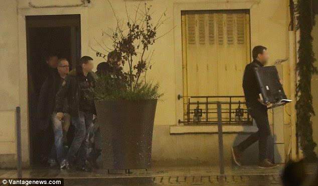 Multiple firearms, including an automatic pistol, and £121,000 in cash were found during the raids that took place across Paris on Monday morning