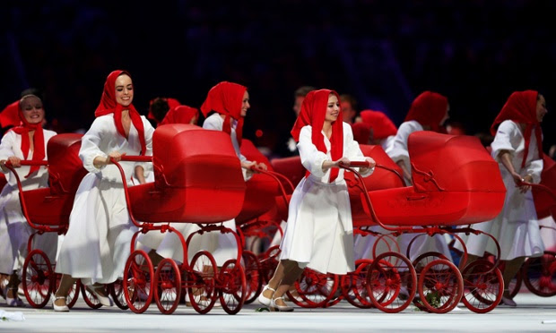 Dancers wearing red babushka's play the role of Mother Russia.