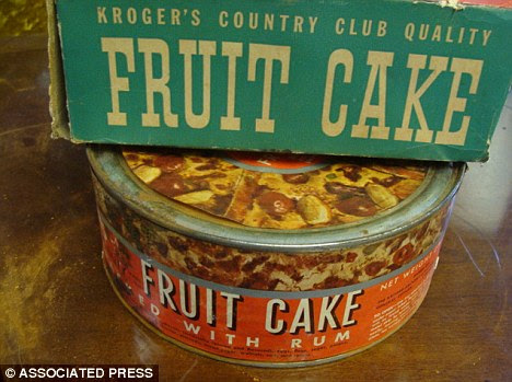 Sold! The fruitcake made in 1941 was returned unopened to a Kroger store in 1971 before auctioned off for $525 Thursday
