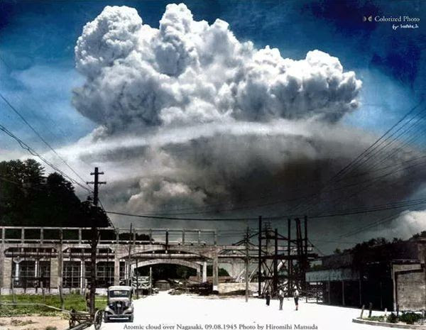 A colorized photo of the mushroom cloud above Nagasaki, Japan...on August 9, 1945.