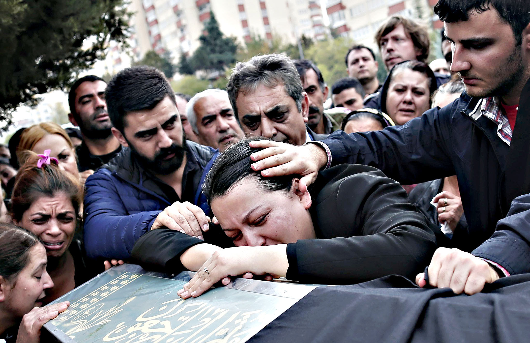 Relatives of Uygar Coskun, who was killed the previous day in a twin blast in Ankara, mourn over his coffin during a funeral ceremony in Ankara, Turkey, 12 October 2015. Mourners anxiously began to gather to commemorate the 95 people killed in twin blasts the previous day at a pro-Kurdish peace rally, the worst attack in Turkey's modern history. No group claimed responsibility for the attack, which came three weeks before snap general elections set for 01 November and the G20 heads-of-government summit later next month, raising security concerns.