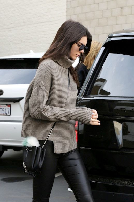 Le Fashion Blog Model Off Duty Style Kendall Jenner Ribbed Asymmetrical Turtleneck Knit Small Bucket Bag With Fur Pom Pom Leather Leggings Via Kendall-Jenner.net