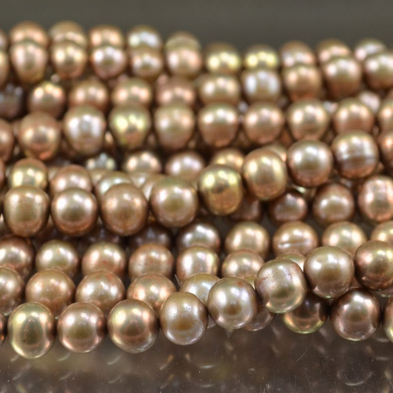 s29431 Freshwater Pearls - 10 mm Near Round Pearl - Light Copper (strand)