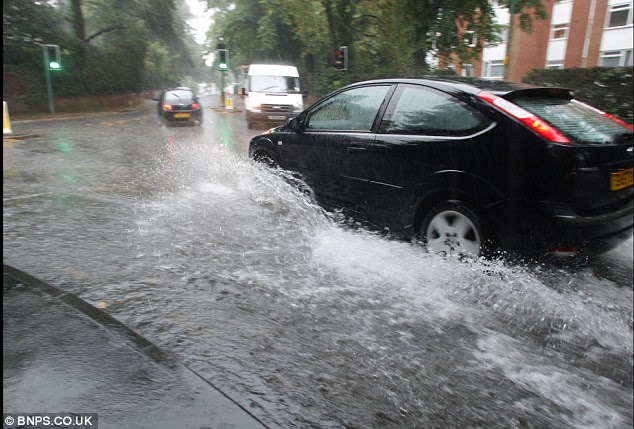 A road is partially flooded in Bournemouth after half an hour of heavy rain