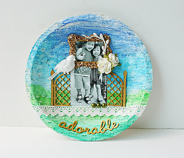 Upcycled pie plate with old book paper