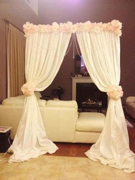 Altar arch made with backdrop stand, cheap fabric, and