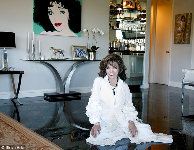 Happiness: At 81, the smile on Joan Collins' face shows she couldn¿t be happier. And the man who has brought that into her life is her fifth husband, Percy Gibson, who is 32 years her junior and who she married in great style at London¿s Claridge's hotel in 2002