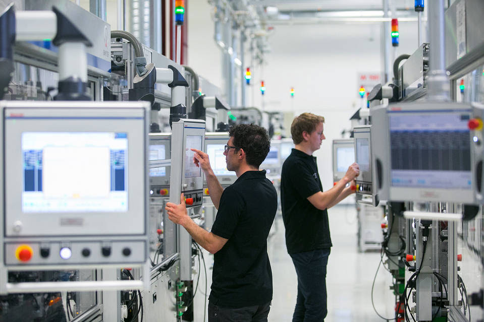 Workers at a Robert Bosch GmbH plant in Blaichach, Germany, use touchscreen panels on the automobile gasoline direct injector valve assembly line. Germany is an export powerhouse.
