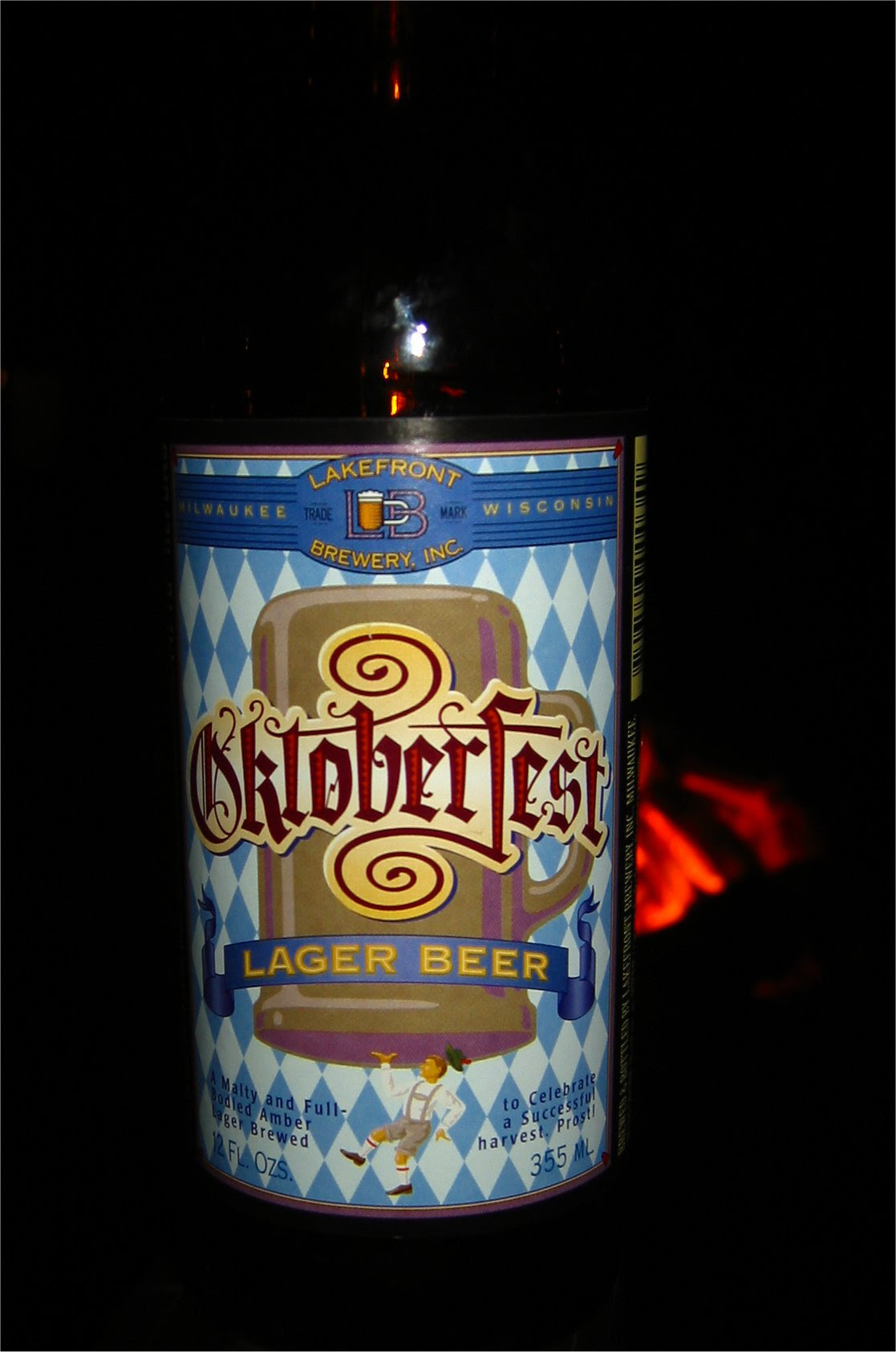LakeFront Brewery Ocktoberfest beet at oktoberfest in Lake Geneva - bonfire in background - soul-amp.com