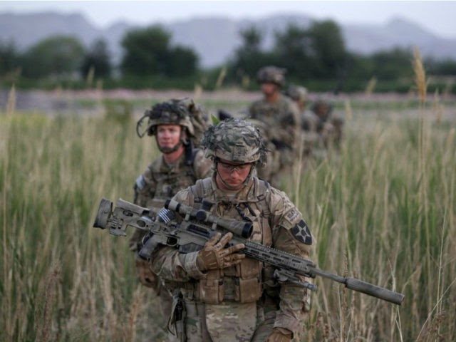 U.S. soldiers from 5-20 infantry Regiment attached to 82nd Airborne walk while on patrol in Zharay district in Kandahar province, southern Afghanistan April 24, 2012. REUTERS/BAZ RATNER