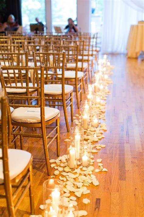candles down the aisle, wedding candles, petals lining the