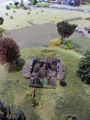 Gun spots tanks coming through wheatfield.JPG