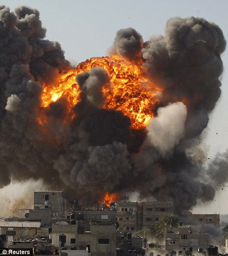 An explosion after an Israeli air strike in Gaza