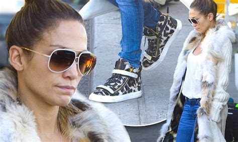 Jennifer Lopez jets into JFK in matching leopard print