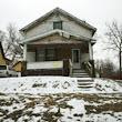 Searching for a family home in a Flint neighborhood hit by arson