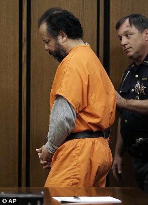 Ariel Castro, is escorted out of the courtroom by a sheriff's deputy on Wednesday, July 24, 2013, in Cleveland
