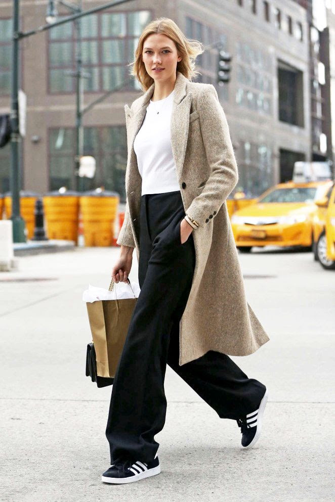 Le Fashion Blog Model Karlie Kloss Fall Winter Style Tweed Texture Mid Length Coat Cropped Sweater Flared Wide Leg Pants Adidas Sneakers