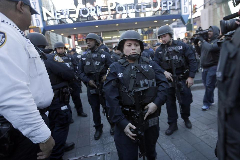 Heavily armed New York city police officers  patroled Times Square on Saturday.