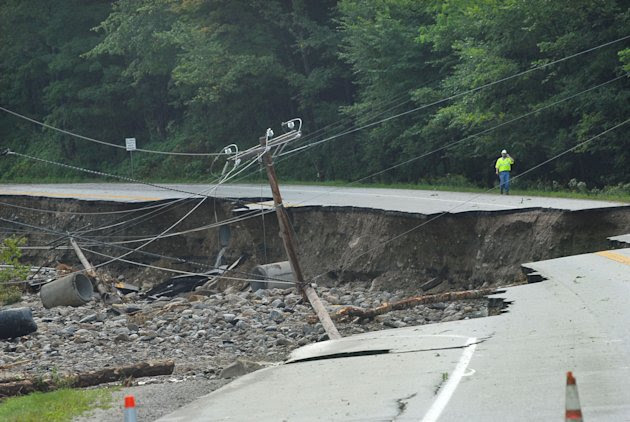 Route 4 in Mendon, Vt. is damaged as work crews evaluate their next move after Hurricane Irene on Monday, Aug 29, 2011. The highway is in between Rutland, Vt., and Killington, Vt.  (AP Photo/The Daily